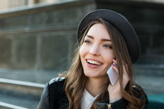 Young beautiful smiling woman talking on cell phone Stock Photo
