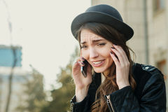 Young beautiful smiling woman talking on cell phone Stock Photography