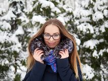 Young beautiful smiling young woman strolling in wintertime outdoor. Winter fun concept. Stock Photography