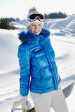 Young beautiful snowboarder Stock Photo
