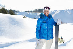 Young beautiful snowboarder Royalty Free Stock Images