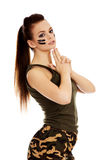 Young beautiful soldier woman doing gun gesture Royalty Free Stock Photography