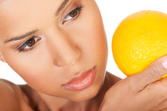 Young beautiful spa woman with orange in her hand Royalty Free Stock Photography