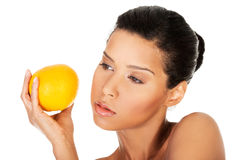 Young beautiful spa woman with orange in her hand Stock Images