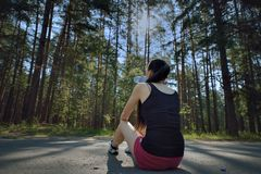 Young beautiful sport woman drinking water after sport Stock Photo