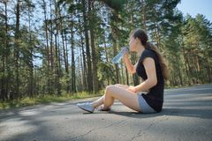 Young beautiful sport woman drinking water after sport Royalty Free Stock Photography