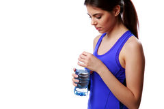 Young beautiful sport woman holding bottle with water Royalty Free Stock Photography