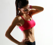 Young beautiful sport woman holding her neck stock photos