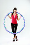 Young beautiful sport woman holding a massage hoop Stock Images