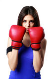 Young beautiful sport woman standing with boxing gloves Royalty Free Stock Photography