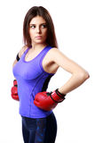 Young beautiful sport woman standing with boxing gloves Royalty Free Stock Images