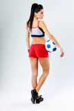 Young beautiful sport woman standing with soccer ball Royalty Free Stock Image