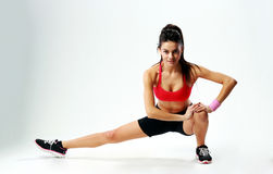 Young beautiful sport woman stretching legs Stock Images