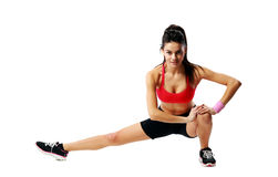 Young beautiful sport woman stretching legs Stock Photos
