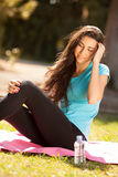 Young beautiful sport woman about to drink water Stock Photo