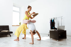Young beautiful sportive couple training partner yoga asanas at home. Stock Photography