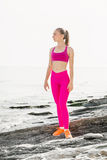 Young beautiful sportive girl training over seaside. Royalty Free Stock Photo