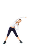 Young beautiful sports girl does fitness exercise stretching Royalty Free Stock Images