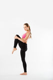 Young beautiful sports girl does fitness exercise stretching Royalty Free Stock Photo