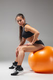 The young, beautiful, sports girl doing exercises Stock Photos