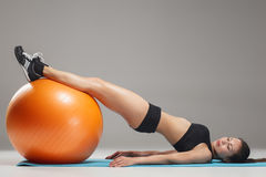 The young, beautiful, sports girl doing exercises on a fitball Royalty Free Stock Image