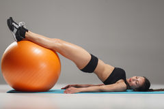 The young, beautiful, sports girl doing exercises on a fitball Stock Photos