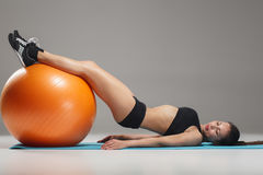 The young, beautiful, sports girl doing exercises on a fitball Royalty Free Stock Images
