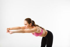 Young beautiful sports girl doing forward bends on press Stock Photo