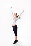 Young beautiful sports girl in full growth happy Royalty Free Stock Photos
