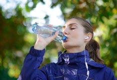Young Beautiful Sports Woman Drinking Water During Exercises royalty free stock photos
