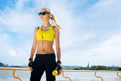 Young, beautiful, sporty and fit girl rollerblading on inline sk Royalty Free Stock Photos