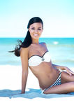 Young, beautiful, sporty and sexy woman on the beach Royalty Free Stock Photo