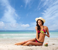 Young, beautiful, sporty and sexy woman relaxing on the beach Royalty Free Stock Image