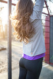 Young beautiful sporty woman doing pull ups Royalty Free Stock Image