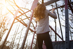 Young beautiful sporty woman doing pull ups Stock Images