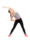 Young beautiful sporty woman exercising Royalty Free Stock Photos