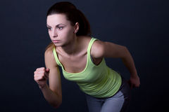 Young beautiful sporty woman running over grey Royalty Free Stock Images