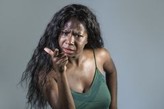 Young beautiful and stressed black African American woman feeling upset and angry gesturing agitated and looking crazy and stock photography