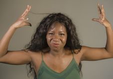 Young beautiful and stressed black African American woman feeling upset and angry gesturing agitated and looking crazy and. Furious arguing or having dispute stock images