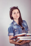 Young and beautiful student with books Royalty Free Stock Photo