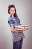 Young and beautiful student with books Stock Photography