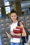 Young beautiful student in college Royalty Free Stock Image