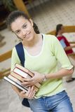 Young beautiful student in college Stock Images