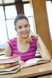 Young beautiful student in college Stock Photos