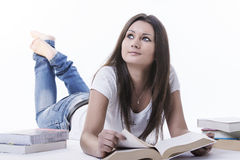 Dreamy student girl reading a book Royalty Free Stock Images