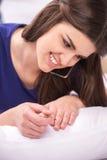 Young beautiful student girl talking. Royalty Free Stock Photos