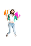 Young beautiful student jumpin with files, workbook. Royalty Free Stock Images