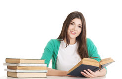 Young beautiful student sitting with book, reading, learning. Stock Photo