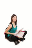 Young beautiful student sitting with book, reading Royalty Free Stock Photography