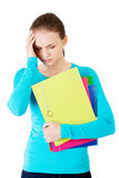 Young beautiful student woman with depression Stock Photo